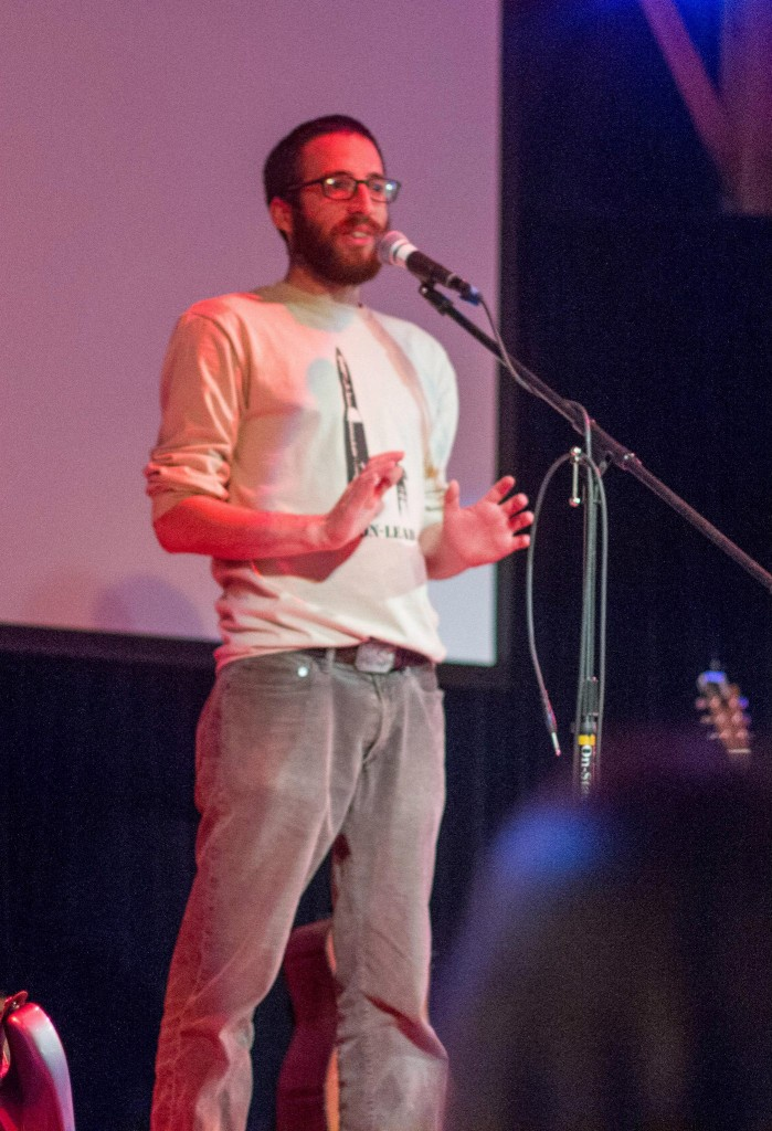 Addressing the crowd at a Wild Lens screening event.  Photo by Eddie Chung.
